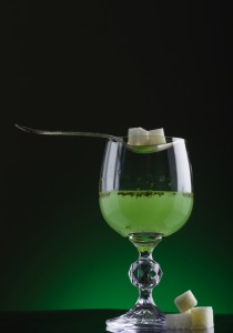 Glass of absinthe with spoon and lump sugar